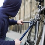 A thief stealing a bike — Image by © Image Source/Corbis
